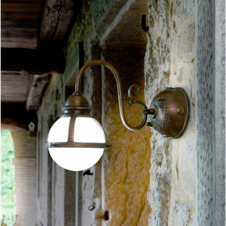 Designer brass and glass wall sconce Cimosa