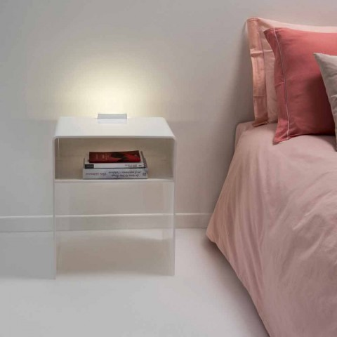 White bedside table with LED light illuminated with Adelia touch