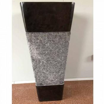 Dark gray pedestal washbasin in natural stone design, unique piece