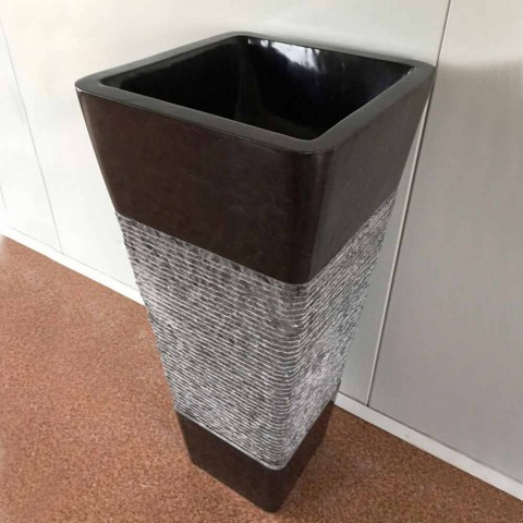 Dark gray pedestal washbasin in natural stone design, unique piece