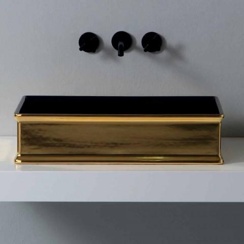 Two-color ceramic countertop washbasin produced in Italy by Debora