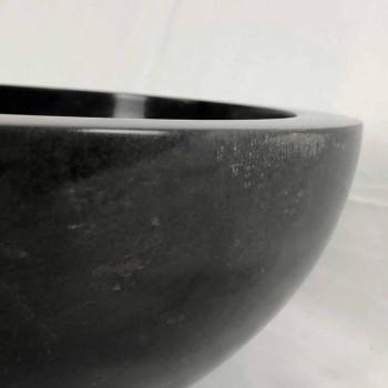 Black round countertop washbasin in Levi natural stone, unique piece