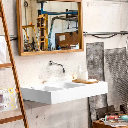 Hanging washbasin with solid surface containing tank Enna