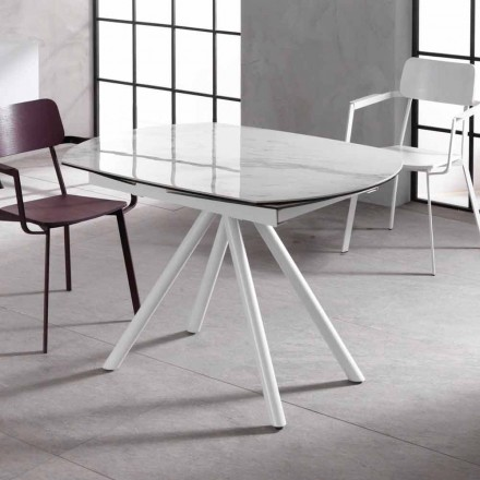 Extensible table with ceramic plan and metal legs Lozzolo
