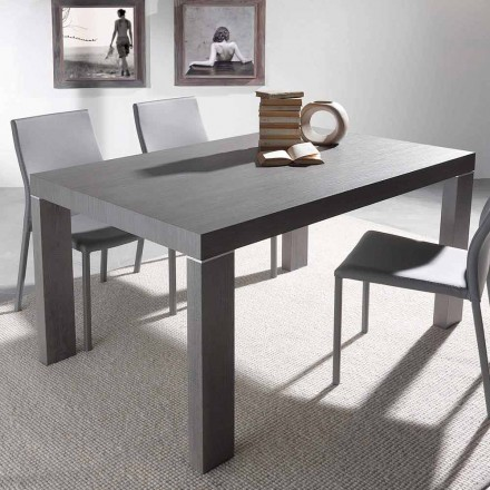 Modern extendable dining table Totem, with solid wood legs
