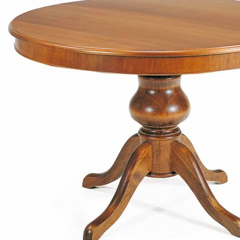 Classic round dining table in solid olive wood